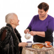 Stock Photo: Mother having tea with her daughter