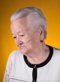 Portrait of smiling old woman — Stock Photo