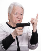 Old woman with pistol — Stock Photo