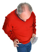 Man getting dollar bills from the pocket — Stock Photo
