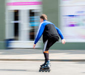 Young man on rollerblades — Stock Photo