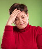 Mature woman suffering from headache — Stok fotoğraf