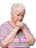 Pensive old woman — Stock Photo