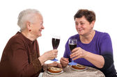 Happy mother with daughter drinking wine — Stock Photo