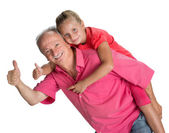 Portrait of a little girl enjoying piggyback ride with her grand — Stock Photo
