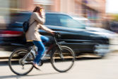 Cyclist in motion riding down the street — Foto Stock