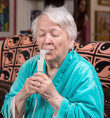 Old woman making an inhalation  — Stock Photo