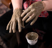 Woman applying spa cosmetic clay cream — Stock Photo