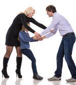 Smutna dziewczyna szuka z rodzicami walki — Zdjęcie stockowe