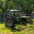 Green old rusty tractor — Stock Photo #47906711