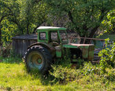 Green old rusty tractor — Stock Photo