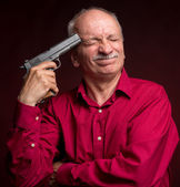 Man with gun wants to commit suicide — Stock Photo