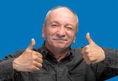 Successful man shows ok sigh — Stock Photo