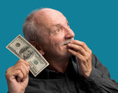 Lucky old man holding dollar bil — Stock Photo
