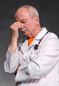 Tired medical doctor with stethoscope — Stock Photo
