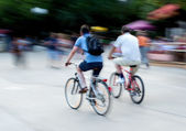 Cyclists on the city roadway — Stock Photo