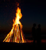 couple against fire background — Stock Photo