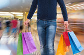 Man with shopping bags — Stock Photo