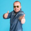 Super excited young man gesturing thumbs up — Stock Photo #50421711