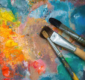 Oil paints and paint brushes — Stock Photo