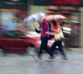 People walking down the street on a rainy day — Stock Photo