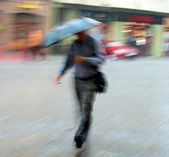 Man walking down the street on a rainy day — Stock Photo