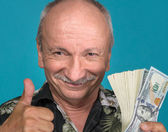 Lucky old man holding dollar bills  — Stockfoto