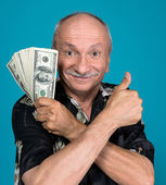 Lucky old man holding dollar bills  — Stock Photo