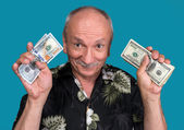 Lucky old man holding dollar bills — Stock Photo