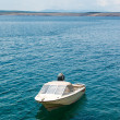 White fishing boat moored in Adriatic sea water — Stock Photo #51409699