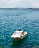 White fishing boat moored in Adriatic sea water — Stock Photo
