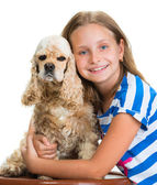 Pretty smiling girl with american spaniel  — Stock Photo