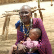 Old Masai Womwith child — Stock Photo #17863425