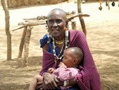 Old Masai Woman with a child — Stock Photo
