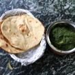 Stock Photo: Indicuisine: chicken in spinach gravy with naan