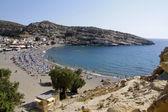 Travel Greece: Matala beach in Crete in Summer — Stok fotoğraf