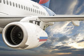 Flight of the Russian aircraft Sukhoi Superjet 100 — Stock Photo