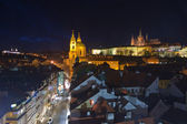 St.Nicholas cathedral and prague hradcany castle in mala strana, — Stock Photo