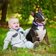 Baby boy with a dog — Stock Photo