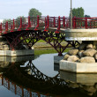Stock Photo: Small arched bridge over river