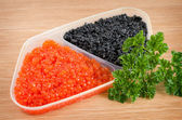 Red and black caviar is in a serving plate — Stock Photo