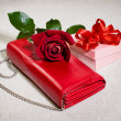 Red purse and gift — Stock Photo