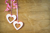 Two hearts hanging on the tape — Stock Photo