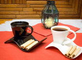 Two cups of coffee and wafer sticks with chocolate — Stockfoto