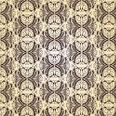 Vintage padrão marrom escura sobre um fundo bege. — Fotografia Stock
