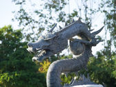 Dragon sculpture in the park — Stock Photo