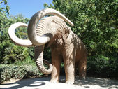 Huge mammoth sculpture in the park — Stock Photo