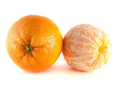 Orange with cleaned orange isolated on white — Stock Photo