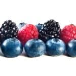 Fresh blueberries, raspberries and blackberries — Stock Photo #25197763
