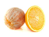 Sliced orange with cleaned orange isolated — Stock Photo